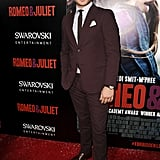 Ed Westwick wore a red suit.