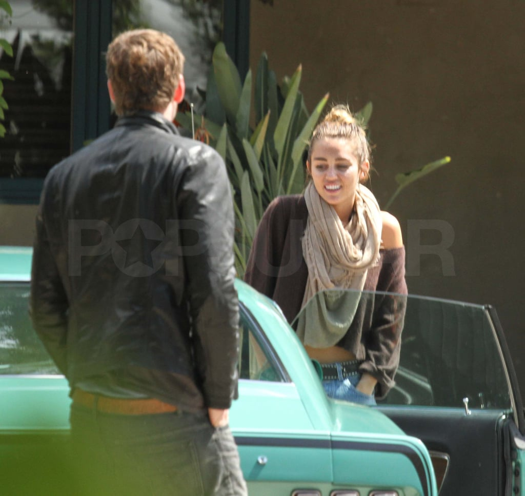 Miley Cyrus and Liam Hemsworth hopped into a mint green Mustang for a ride around LA over the weekend. The couple went casual during the Sunday outing, which came after a more dressed up Saturday evening. Miley and Liam attended Muhammad Ali's Celebrity Fight Night XIII fundraiser in Phoenix, where Miley's huge accessory on her ring finger sparked rumors that the two were engaged. Miley quickly cleared things up on Twitter, saying that the sparkler is actually a topaz that she's been wearing since Nov. They still had exciting news to celebrate though, since Liam's The Hunger Games took the top spot at the box office and broke midnight opening records. He's still talking about the action movie, and stopped by Conan on Monday night to chat up the film. His costar, Jennifer Lawrence, is also continuing to do press with her latest travels taking her to London.