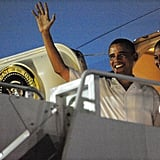 Barack and Michelle Obama wave before boarding Air Force One as they depart Honolulu on January 3.