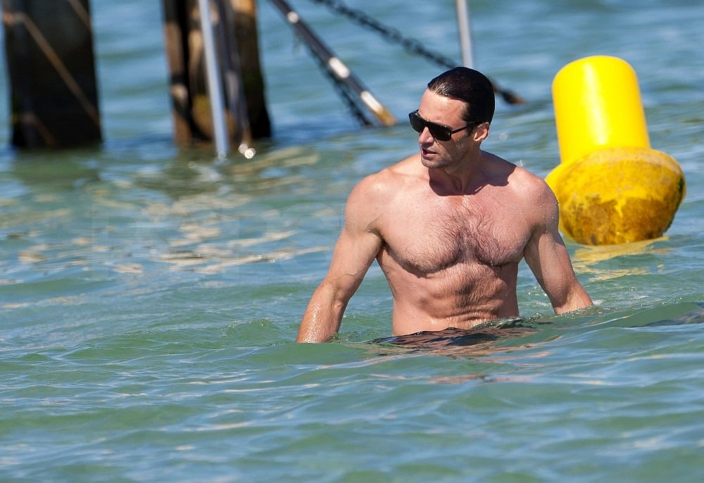 Hugh wore sunglasses in the water.