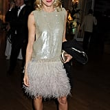 Naomi Watts stepped out in a feather-skirted silver frock.