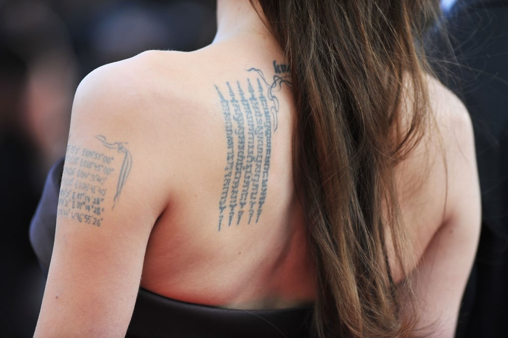 Buddhist Pali Incantation On Her Left Shoulder Blade Angelina