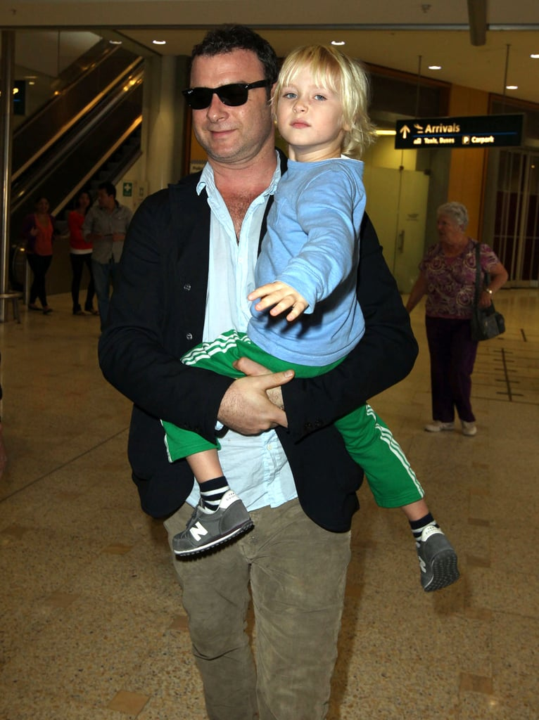 Liev Schreiber walked with Sasha Schreiber through the Sydney airport.