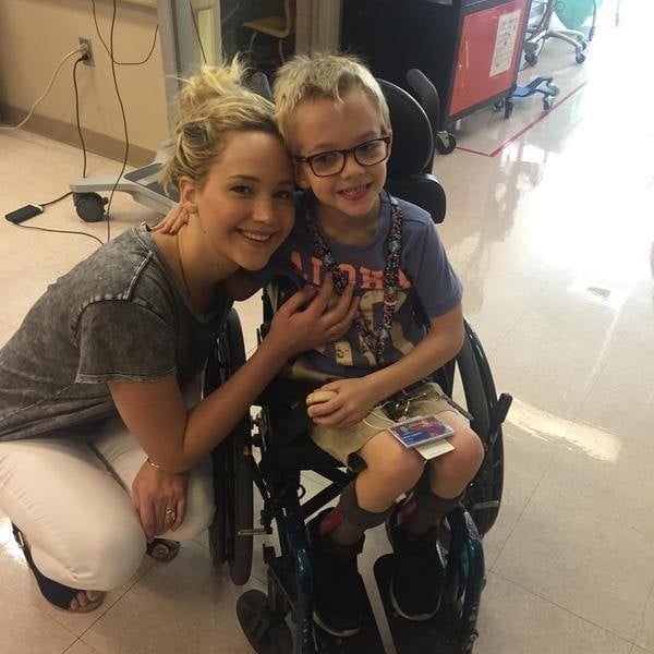 "Jennifer Lawrence spent her Friday paying it forward. During a break from filming X-Men: Apocalypse in Canada, the actress stopped by Shriners Hospital for Children in Montreal for an adorable visit with young patients. The photos show the Oscar winner cuddling up to a new buddy, hugging little girls, signing her autograph on little guy's arm cast, and posing for a group photo with staff. Throughout all the sweet moments, Jennifer's infectious smile lights up the room. ""A very special visitor stopped by our Canada hospital today,"" the hospital's staff wrote in their epic Facebook post. ""Jennifer Lawrence is in Montreal filming a new movie and she made time to visit some of our ‪#‎ShrinersCanada‬ kids and staff. Everyone had a great time!"" Jen's visit comes more than a week after Jennifer had a blast with new pal Amy Schumer on a beach day. Read on for photos of Jennifer's cute day with kids, and then see all the ways her 2015 has been awesome."