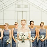 All of this bride's bridesmaids wore matching knee-length blue lace dresses.
