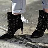 A close-up on a pair of embellished Zara booties with that perfect downtown bit of edge.