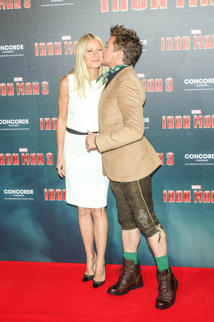 Gwyneth Paltrow got a kiss from Robert Downey Jr. at the Iron Man 3 photocall in Munich.