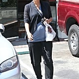 Halle covered up while grabbing lunch with a friend. The main attraction to her look here was her newsboy cap.