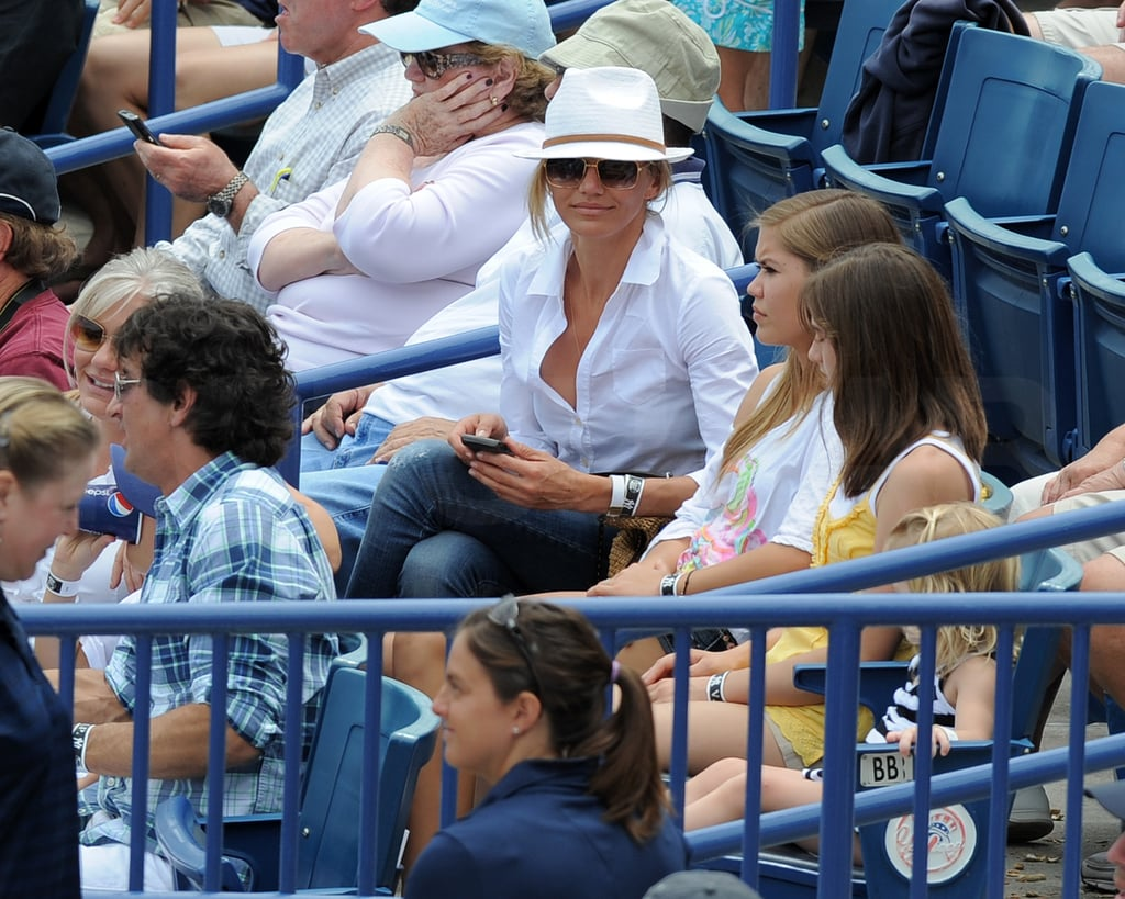 Cameron Diaz had a few young pals for company yesterday as she watched her boyfriend, Alex Rodriguez, take the field in Tampa for a Yankees Spring training game. She kept out of the sun with one of her trademark fedoras, but the topper didn't hide her identity from fans who wanted to say hello. Cameron treated herself to a midday drink while watching Alex run, stretch, and man third base in the successful matchup against the Detroit Tigers. She's back with Alex and his daughters following a visit home to LA. Alex's baseball schedule will soon bring the jet-setting couple up to NYC, where he recently bought a $6 million penthouse. His property empire also apparently includes investments around Florida, and one apartment building is finally getting some repairs after years of complaints from tenants.