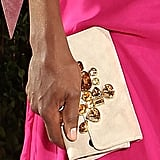Venus Williams paired a jeweled clutch with her bold-hued gown.