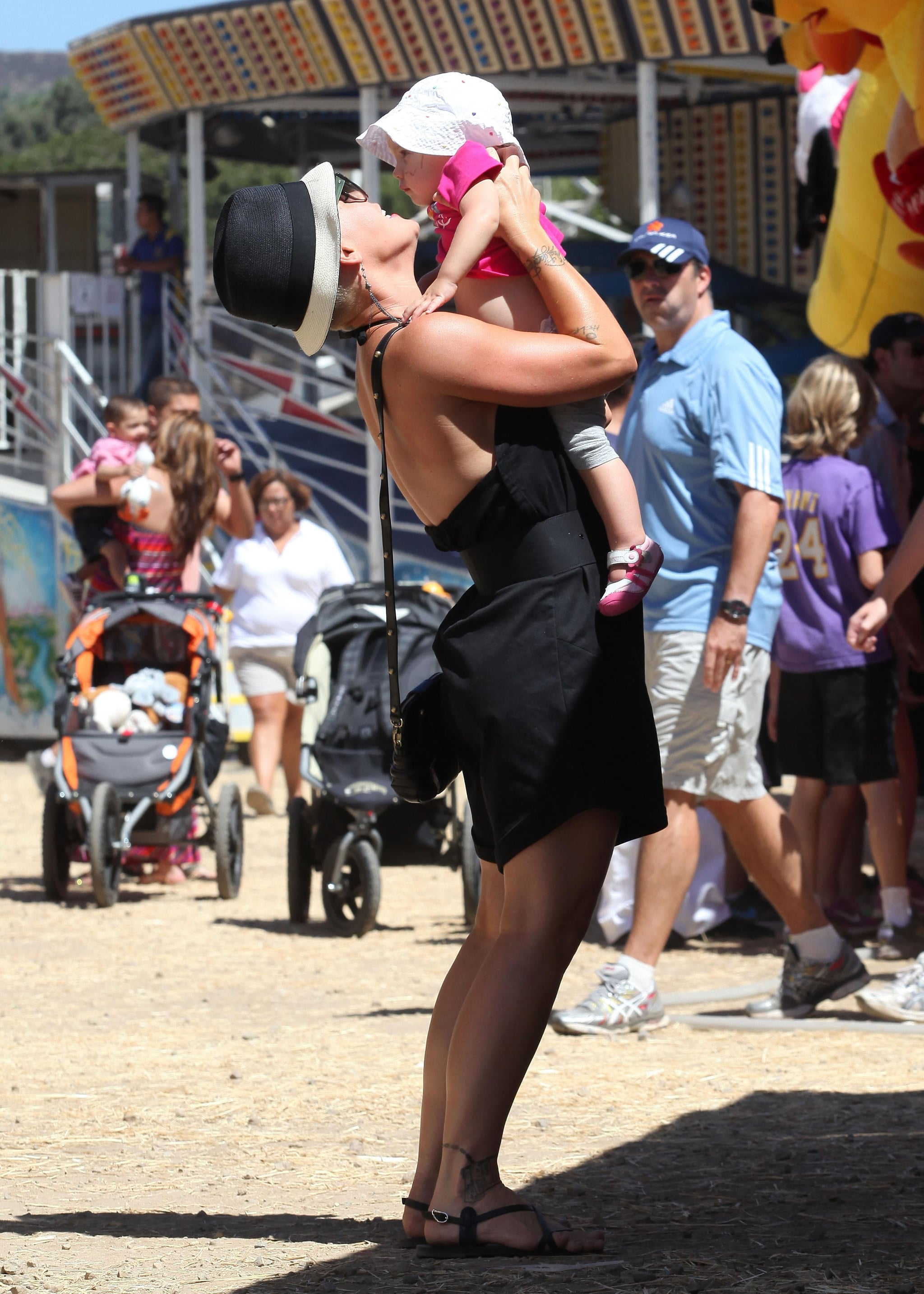 Pink gave daughter Willow a kiss at the fair in LA.