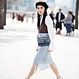 Add a netted beret to a chic, layered look.
