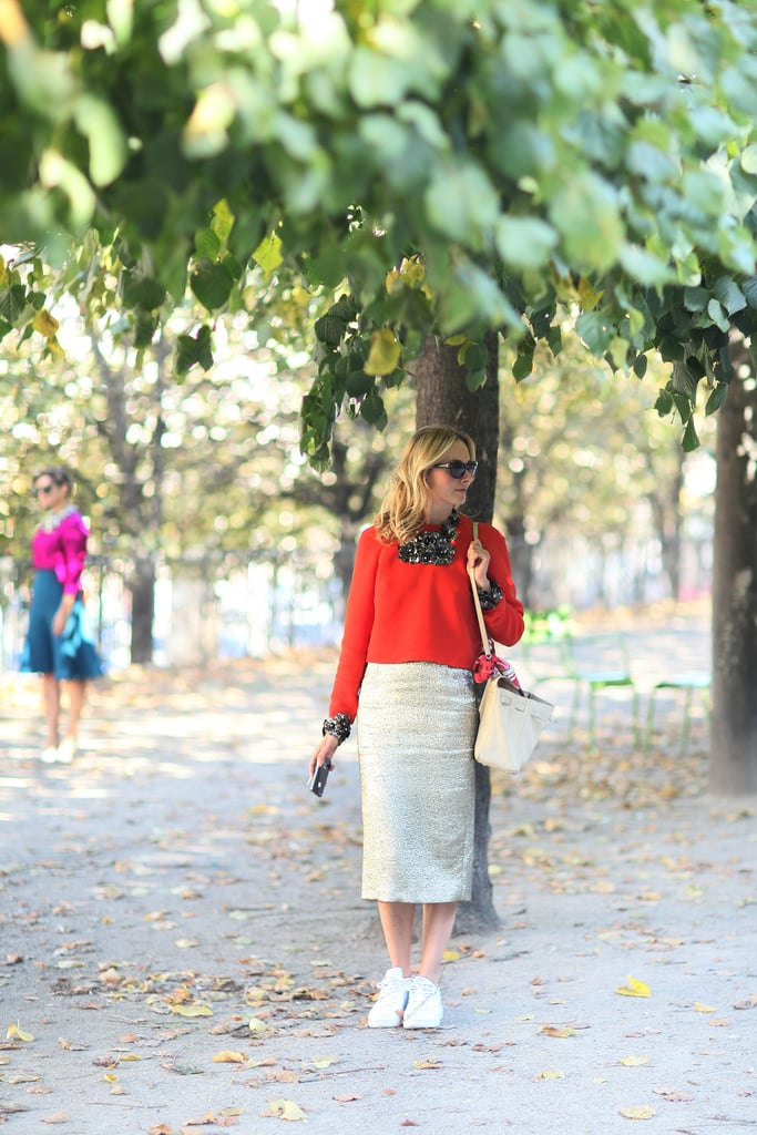 A gold pencil skirt is the perfect foil to a poppy-red pullover.