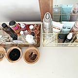 "Best beauty organization tips:   ""Keep a separate travel bag with duplicates of your favorite products. It makes packing super quick and there is something so calming about traveling and pulling out your favorite stuff.""  ""If it's a pretty product, place it on a tray with apothecary jars and a candle to add some glamour to your vanity."""