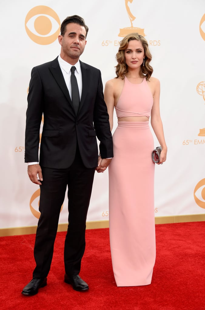 """Rose Byrne made a sleek and streamlined appearance on the Emmy Awards red carpet in a pale pink Calvin Klein ensemble, with the fashion-forward actress showing off a hint of her midriff. The actress, who starred on US show Damages for years, is there to support her boyfriend Bobby Cannavale, who just won the best supporting actor in a drama series Emmy for his work in Boardwalk Empire — in his speech he just called her out as """"the love of my life, Rose."""" What do you think of Rose's look? Weigh in on our fashion and beauty polls."""