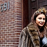 This woman's head-turning gold crown really popped against her deep berry lips. And if you're going to wear a crown, there's no better time than Fashion Week to do it.