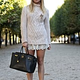 A cozy knit balances out lacy shorts — while her Valentino heels punch it up.