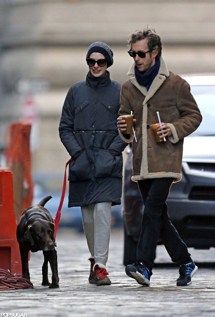 Anne Hathaway and her husband, Adam Shulman, took an early-morning stroll with their dog, Esmeralda, yesterday in NYC. Adam had his arm around Anne for much of their walk as the two braved the chilly weather and stopped for a juice. The couple just returned from their New Year's trip to Switzerland in time for Anne's appearance on The Daily Show With Jon Stewart on Monday. During the show, Anne talked about a few of the funny Les Misérables bloopers that happened during filming.  Les Mis is already racking up award-season recognition, including 11 nods at this evening's Critics' Choice Awards. The honors began on Monday, though, when she and the cast attended the National Board of Review Gala, where they were awarded best cast and the project was named among the best movies of the year. Anne also received solo nominations for best supporting actress at both the SAG Awards and the Golden Globes. The Golden Globes air this Sunday, so be sure to fill out our Golden Globes ballot for a chance to win an iPad Mini!