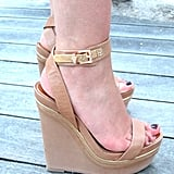 This styler knows nude-hued wedges do wonders for your stems.