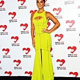 Olivia Munn wore a neon yellow gown.