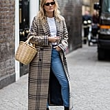 Throw on with a checked coat over a classic white tee and jeans.