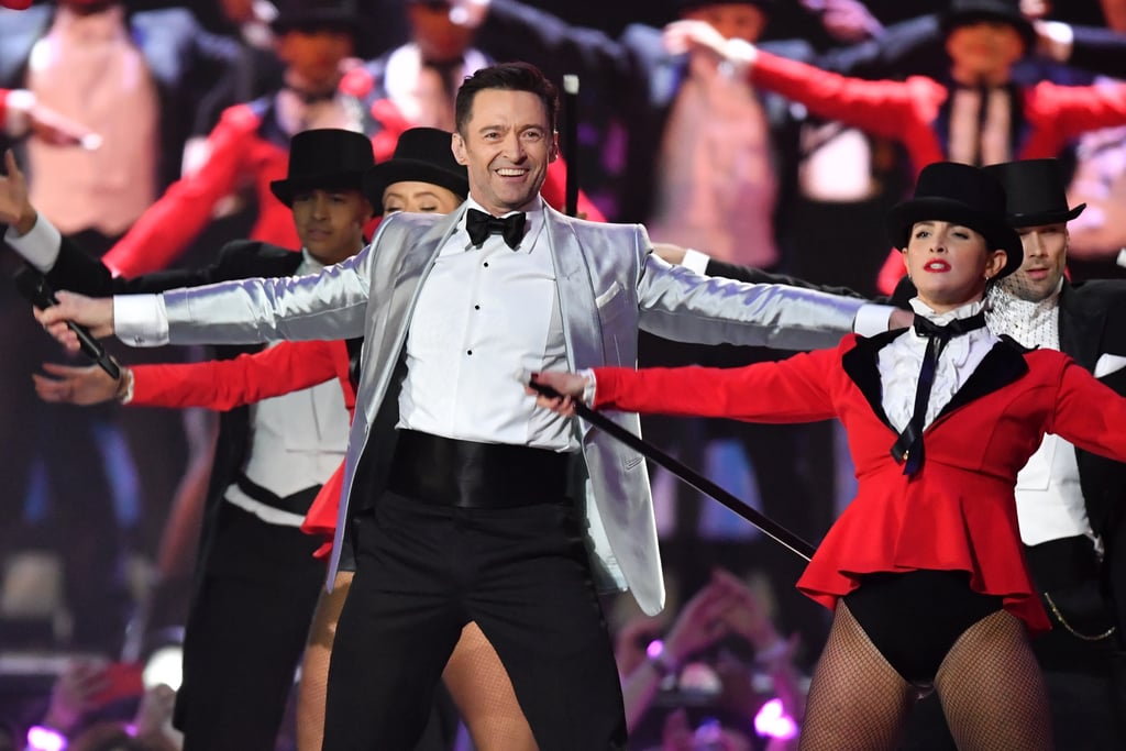 "Hugh Jackman! Acrobatics! A metallic blazer! Massive amounts of confetti! Those were the very cornerstones of the entertaining opening at the 2019 Brit Awards on Feb. 20. Jackman kicked off the show with a festive performance of ""The Greatest Show"" from The Greatest Showman. (The song also opens the movie musical!) Yes, the film might be two years old now and Jackman wasn't actually up for any awards at the Brits, but who cares! It offered a good opportunity as any to see the triple threat take the stage. See snippets and pictures from the performance ahead.      Related:                                                                                                           Beyoncé and JAY-Z Accept Their Brit Award With a Stunning Ode to Meghan Markle"