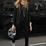 Cara Delevingne channeled Ozzy Osbourne in her round metal sunglasses in London. Her all-black ensemble, including a Saint Laurent blazer, got a pop of shine thanks to her metallic silver high-top sneakers.