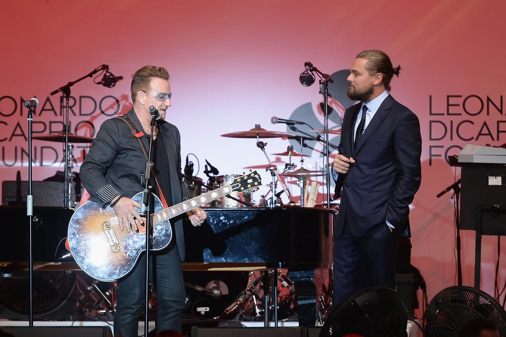 Leo watched as Bono played guitar.