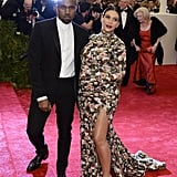 Alongside Kanye West, Kim Kardashian's floral Givenchy by Riccardo Tisci gown featured matching gloves and a high neckline to offset a thigh-high slit.