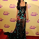 Katy Perry sported long longs and a red and turquoise gown by Elie Saab.