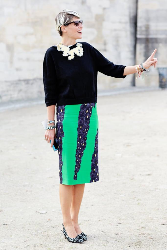 Just because you are going to work, doesn't mean you have to say goodbye to bright colours and summer florals.  Elisa Nalin shows us the best way to mix prints and wear colour to work.  She balances the bold green hue with a sleek silhouette, low heels (which are an office favourite) and a statement necklace - that gives her plain black top a little bit of an edge. Work ready and very chic.