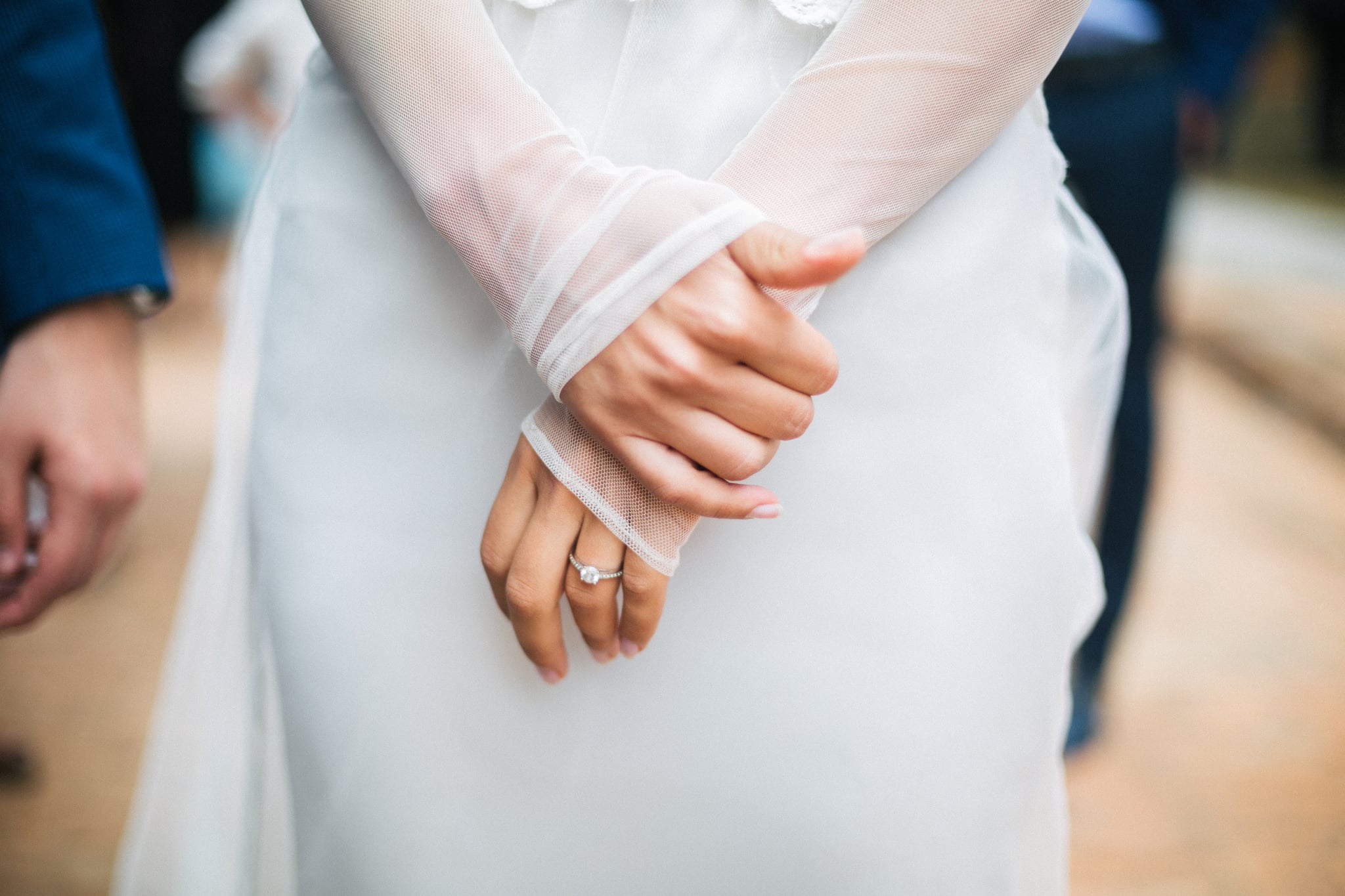 Brides hands with ring