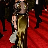 Rosie showed off her punk side at the 2013 Met Gala in a Gucci gown that had a sheer top and featured sequin detailing.