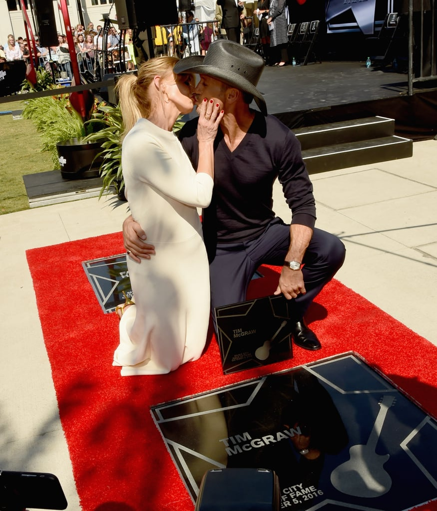 "Faith Hill and Tim McGraw were honored with matching stars on the Music City Walk of Fame in Nashville on Wednesday. The couple spoke on stage before posing together on their stars and sharing a sweet smooch for the cameras (Faith also laid a big fat kiss on her star). They were also joined by country legend Reba McEntire, who said a few words about them to the crowd.   On Tuesday night, Faith and Tim announced that they would be going on their first tour together in a decade. During their joint show in Nashville, Faith told the crowd, ""OK, so we are going back on the road, on tour. We are going to go from side to side, South to North, all the way around the globe."" Their Soul2Soul World Tour 2017 will be the third Soul2Soul tour for the couple. Tim and Faith recently rang in another huge milestone when they sent their eldest daughter, Maggie, to college, and they are celebrating their 20th wedding anniversary on Oct. 6.      Related:                                                                                                           22 Pictures of Tim McGraw and Faith Hill's Epic Love Story"