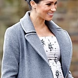 Meghan Markle Touching Baby Bump Pictures