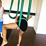 Jamie Chung got all tied up and twisted in aerial yoga.