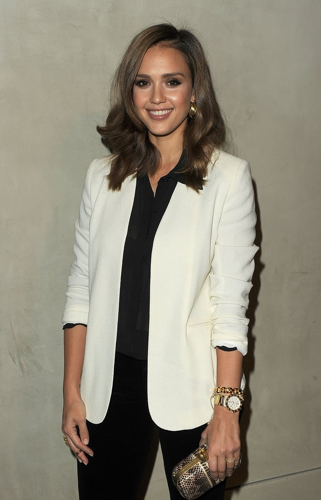 Jessica Alba wore a chic black and white look to a dinner for Vanity Fair in LA.