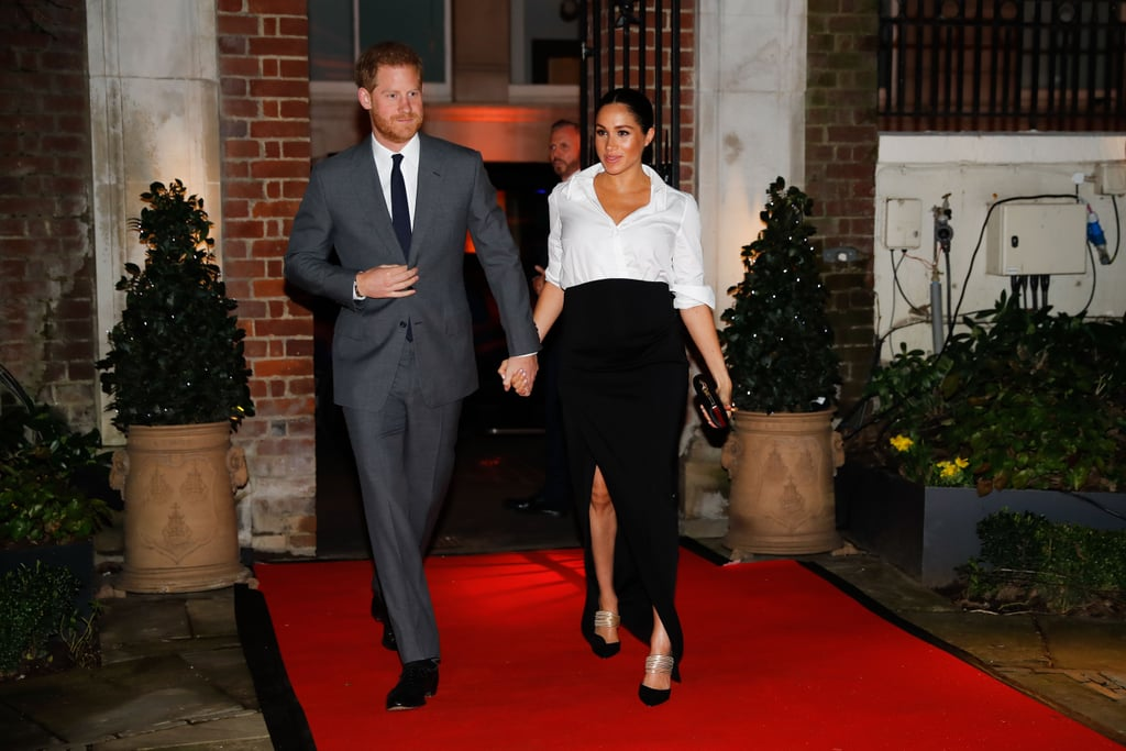 On Thursday night, Prince Harry and Meghan Markle stepped out in London for the Endeavour Fund Awards. It's the royal couple's second time attending the ceremony, and a lot has changed since their first visit in 2018. Back then, Meghan and Harry had been engaged for a couple of months, and she was still getting used to being in the royal spotlight. A year later, Meghan is now Duchess of Sussex, pregnant with her and Harry's first child, and a dab hand at royal engagements. It's no surprise, then, that her wardrobe has evolved with her royal role.      Related:                                                                                                           From Beach Dresses to Ballgowns, Meghan Markle's Maternity Style Was Totally on Point               Back in 2018, Meghan's look for the awards consisted of an Alexander McQueen suit, a pussy bow blouse, and a pair of black pumps. This time around, she stuck to the white shirt, but this time she wore a classic button down tucked into a chic black maxi skirt with a split. The design is a custom creation by her wedding dress designer, Clare Waight Keller for Givenchy. With her sleeves rolled up, Aquazzura heels, and a Givenchy clutch in hand, she looked every inch the glamorous duchess as she and Prince Harry arrived at Goldsmiths' Hall for the event. Keep reading to take a closer look.