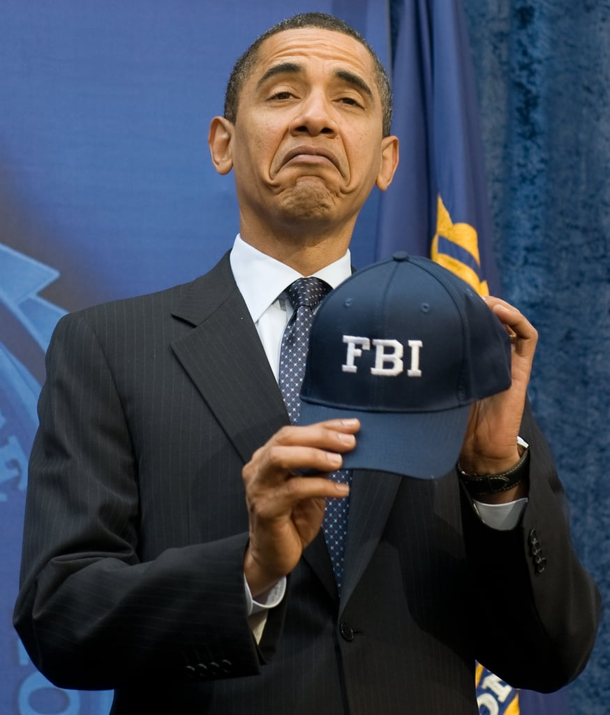 Showing off his FBI hat in 2009.  381d0e201b4