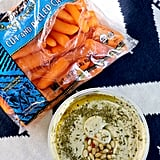 Serve the carrots and hummus straight from their packaging.