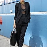 Slick suiting with more femininity via a peplum at the waist and a darker side via a sheer top.