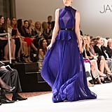Jaws dropped when this bright purple chiffon gown hit the runway — we can't wait to see the reaction it gets on the red carpet.
