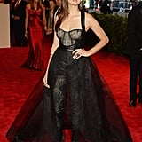Nina Dobrev's custom Monique Lhuillier number incorporated a bevy of interesting details: lace pants enveloped in a sheer black skirt and a corset top with a black leather overlay. She added on black Rupert Sanderson pumps and Kimberly McDonald jewels.