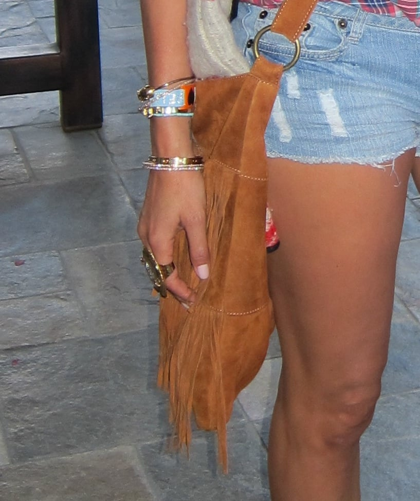Suede fringe and gold bracelets make for a cool hippie vibe.