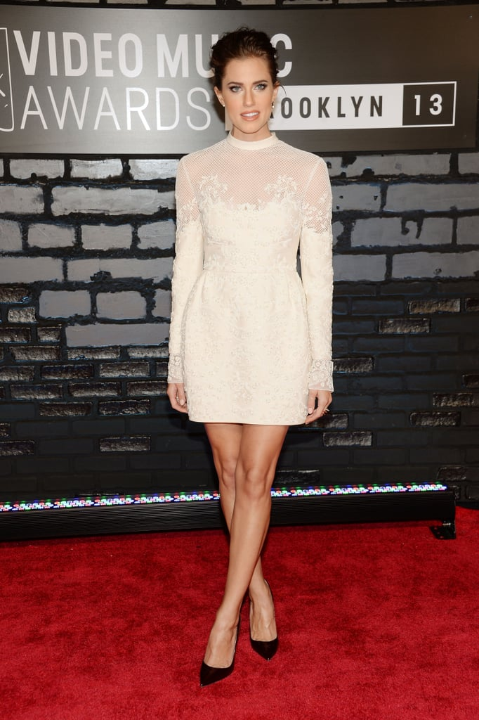 Allison Williams was ladylike in a long-sleeved sheer off-white minidress, oxblood patent Christian Louboutin pumps, and Phyne by Paige Novik jewelry.