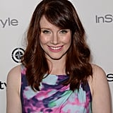 Bryce Dallas Howard styled her auburn hair in loose waves. For her makeup, she paired a flick of eyeliner with a bright pink lip.