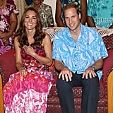 Kate laughed sitting next to her husband.