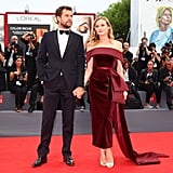 Diane Kruger wore a romantic oxblood Boss dress with major details from the off-the-shoulder neckline to the side bow and train. She chose champagne-colored peep-toe heels to play up her gold earrings.
