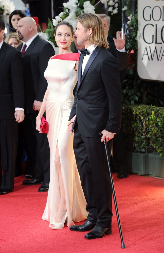 Brad Pitt wore a tux and Angelina Jolie wore Atelier Versace.