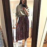 One hoodie two ways! Dana rocked the same colorway with a pleated midi skirt and her white leather ankle boots.
